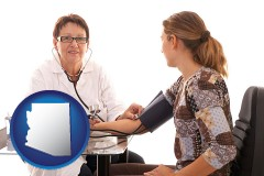 arizona a female nurse practitioner checking a patient's blood pressure