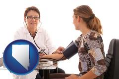nevada a female nurse practitioner checking a patient's blood pressure