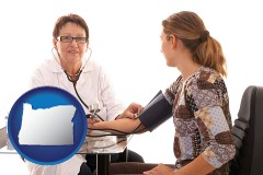 oregon a female nurse practitioner checking a patient's blood pressure