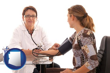 a female nurse practitioner checking a patient's blood pressure - with Arizona icon
