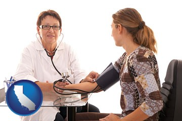 a female nurse practitioner checking a patient's blood pressure - with California icon