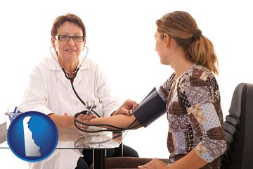 a female nurse practitioner checking a patient's blood pressure - with Delaware icon