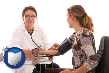a female nurse practitioner checking a patient's blood pressure - with Ohio icon