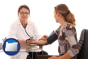 a female nurse practitioner checking a patient's blood pressure - with Oregon icon