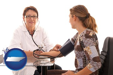 a female nurse practitioner checking a patient's blood pressure - with Tennessee icon